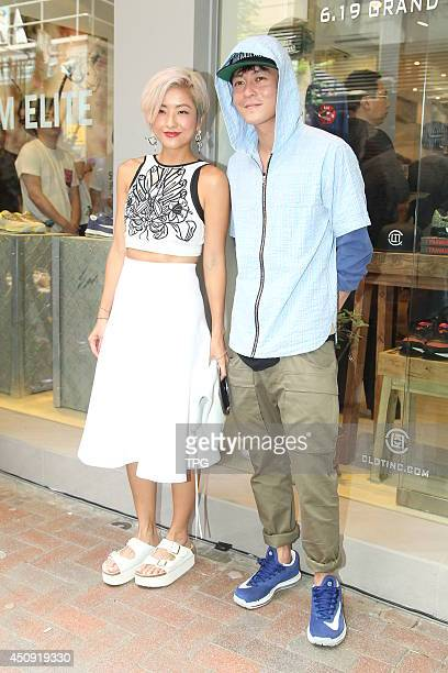 Edison Chen and Hilary Tsui attend the opening ceremony of Juice on Thursday June 192014 in Hong KongChina