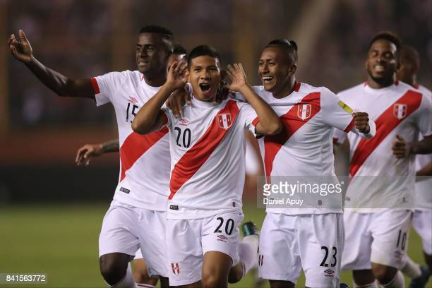 Edison Flores celebrates with Pedro Aquino and Christian Ramos after scoring the first goal of his team during a match between Peru and Bolivia as...