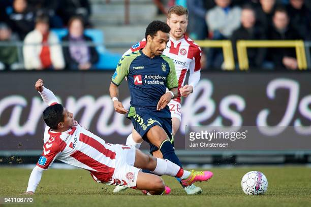 Edison Flores of AaB Aalborg and Hany Mukhtar of Brondby IF compete for the ball during the Danish Alka Superliga match between AaB Aalborg and...