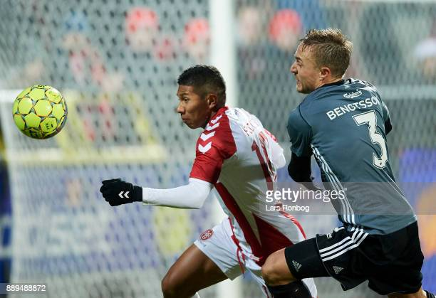 Edison Flores of AaB Aalborg and Pierre Bengtsson of FC Copenhagen compete for the ball during the Danish Alka Superliga match between AaB Aalborg...