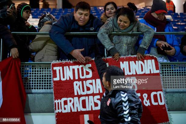 Edison Flores of AaB Aalborg celebrate wth fans from Peru after the Danish Alka Superliga match between Lyngby BK and AaB Aalborg at Lyngby Stadion...