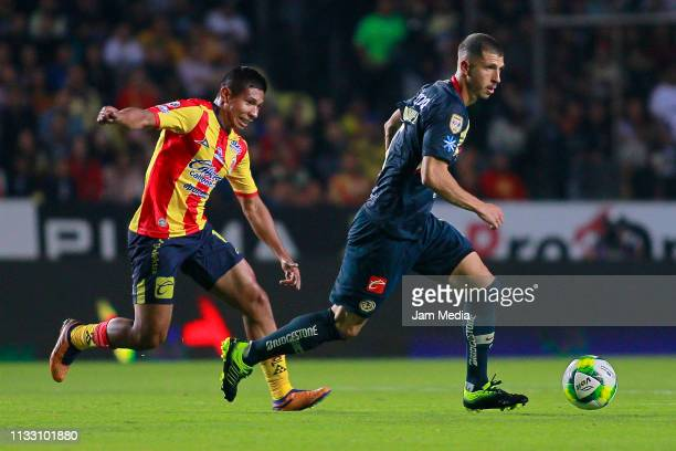 Edison Flores of Morelia fights for the ball with Guido Rodriguez of America during the 9th round match between Morelia and America as part of the...