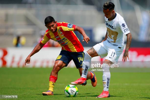Edison Flores of Morelia fights for the ball with Martin Rodriguez of Pumas during a 10th round match between Pumas UNAM and Morelia as part of...