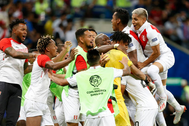Edison Flores of Peru celebrates with teammates after scoring the winning penalty during a penalty shootout after the Copa America Brazil 2019...