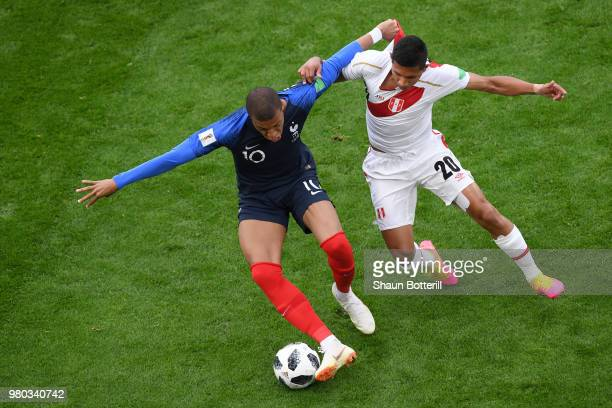 Edison Flores of Peru closes down Kylian Mbappe of France during the 2018 FIFA World Cup Russia group C match between France and Peru at Ekaterinburg...