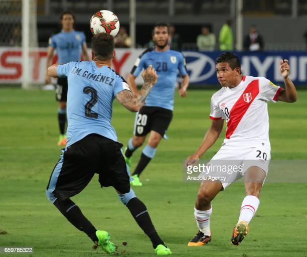 Edison Flores of Peru in action against Jose Gimenez of Uruguay during 2018 FIFA World Cup Qualification match between Peru and Uruguay at National...