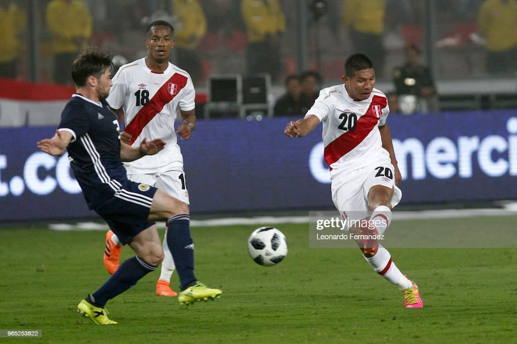 Edison Flores of Peru kicks the ball against Lewis Stevenson of Scotland during the international friendly match between Peru and Scotland at Estadio Nacional de Lima on May 29, 2018 in Lima, Peru.