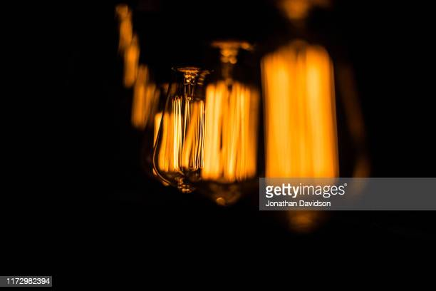 edison lightbulbs - filament stock photos and pictures