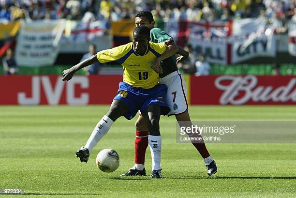 Edison Mendez of Ecuador shields the ball from Ramon Morales of Mexico during the FIFA World Cup Finals 2002 Group G match played at the Miyagi...