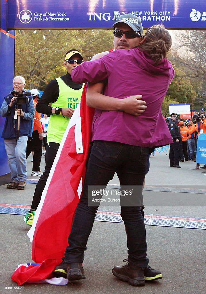 Edison Pena (C), one of the recently rescued Chilean miners, embraces his wife Angelica Alvarez after completing the 41st ING New York City Marathon on November 7, 2010 in New York City.