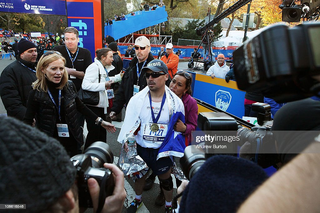 Edison Pena (C), one of the recently rescued Chilean miners, is swarmed by the media after completing the 41st ING New York City Marathon on November 7, 2010 in New York City.