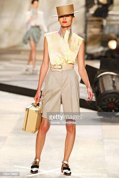 Edita Vilkeviciute walks the runway at Isaac Mizrahi Spring 2010 during MercedesBenz Fashion Week at Bryant Park on September 17 2009 in New York City