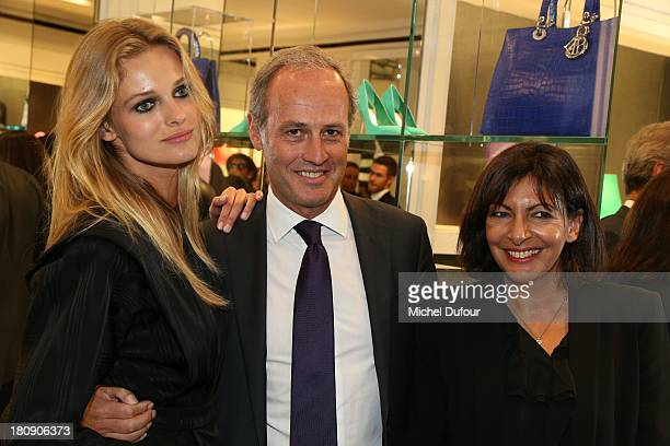 Edita Vilkeviciute Xavier Romatet and Anne Hidalgo attend the Vogue Fashion Night In Paris at Dior rue Royale on September 17 2013 in Paris France