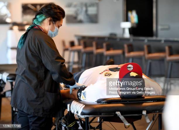 Edith B Fernandez draws blood from Luis Fregoso a Galaxy fan inside the Stadium club at Dignity Health Sports Park in Carson on Thursday May 21 2020...