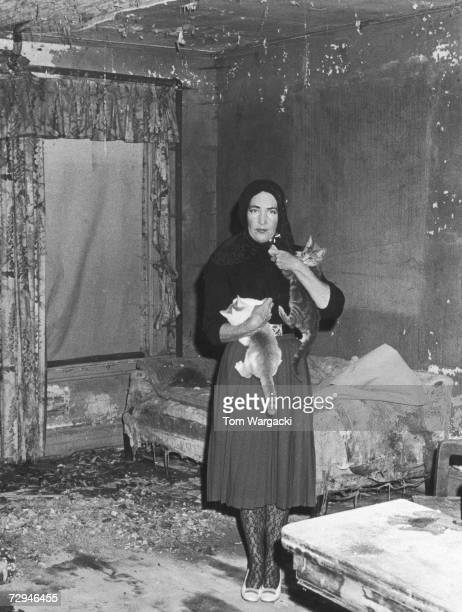 Edith Bouvier Beale a cousin of Jacqueline Kennedy Onassis at home with her cats in Grey Gardens a rundown mansion in East Hampton New York circa 1975