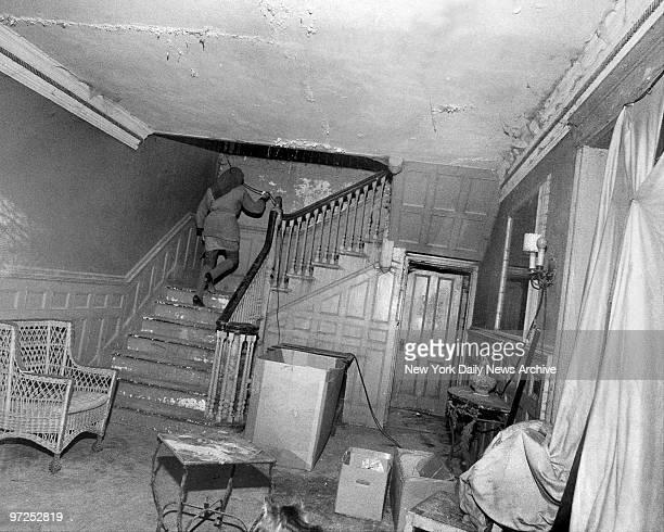 Edith Bouvier Beale walkd upstairs from halfpaneled hall