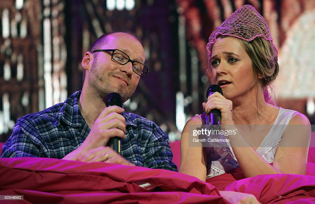 Edith Bowman and Adrian Edmondson perform at the ninth eviction show for 'Comic Relief Does Fame Academy' at Lambeth College on March 9, 2005 in London. The new series sees 13 celebrities go head to head in the ultimate celebrity singing competition, with the grand final announcing the winner on March 11, Red Nose Day 2005.