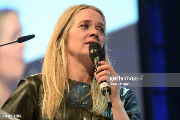 Edith Bowman shows emotion on stage during the Nordoff Robbins O2 Silver Clef Awards 2019 at Grosvenor House on July 05 2019 in London England
