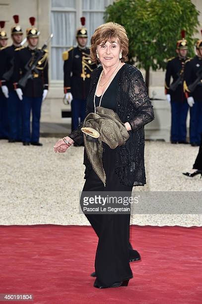 Edith Cresson arrives at the Elysee Palace for a State dinner in honor of Queen Elizabeth II hosted by French President Francois Hollande as part of...