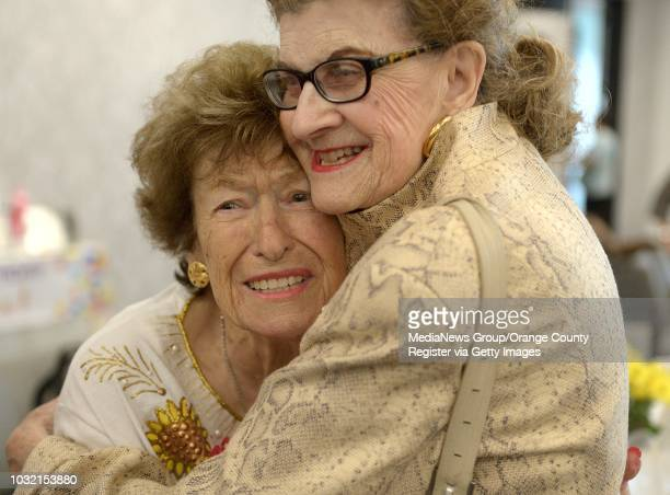 Edith Edie Wins left gets a hug from friend Lucy Becker during her 100th birthday party at Temple Beth Sholom on Tuesday in Santa Ana ///ADDITIONAL...