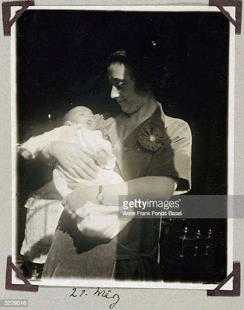 Edith Frank holds her baby daughter Margot Anne Frank's older sister in a patch of sunlight Frankfurt am Main Germany Taken from the photo album of...