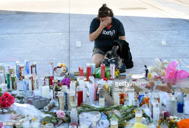 Edith Garcia of Nevada wipes her eyes at a makeshift memoral set up along the Las Vegas Strip on October 4 2017 in Las Vegas Nevada The memorial made...