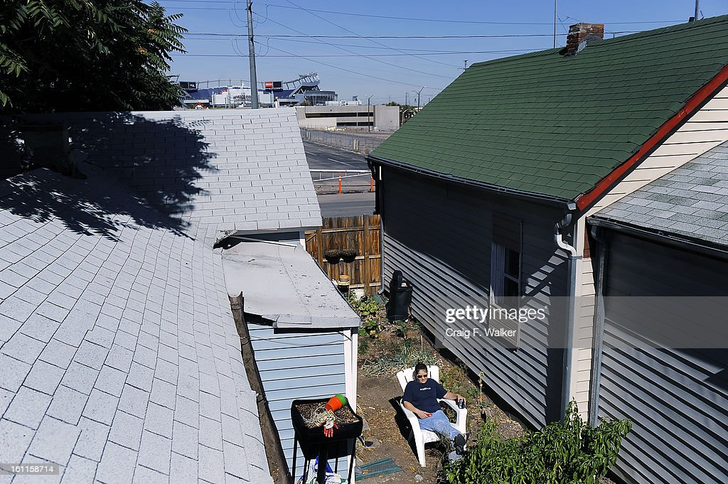 Edith Gonzalez takes a break from yard work at her home she shares with her husband Isidro on West 13th Ave in the Sun Valley neighborhood of Denver CO. & Edith Gonzalez takes a break from yard work at her home she shares ...