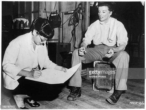 Edith Head and Katharine Hepburn on the set of the film 'The Rainmaker' 1956