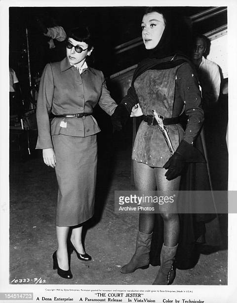 Edith Head checks the costume she designed on Glynis Johns in a publicity portrait for the film 'The Court Jester' 1956
