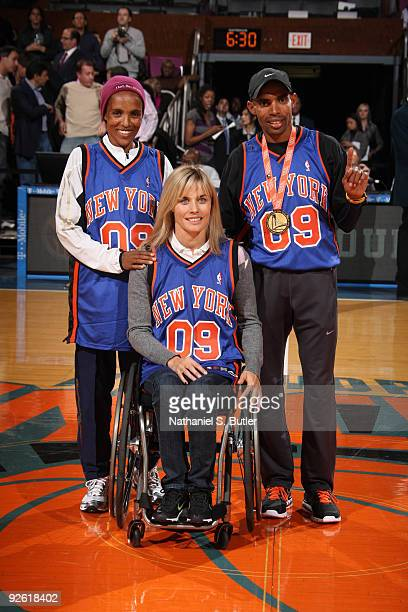 Edith Hukeler Deratu Tulu and Meb Keflizghi winners of the NYC Marathon take center court for recognition during a game between the New York Knicks...