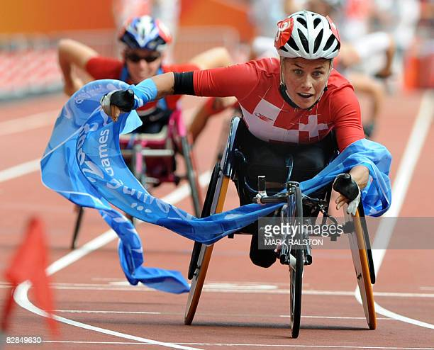 Edith Hunkeler of Switzerland celebrates after winning the final of the women's marathon T54 classification event at the 2008 Beijing Paralympic...