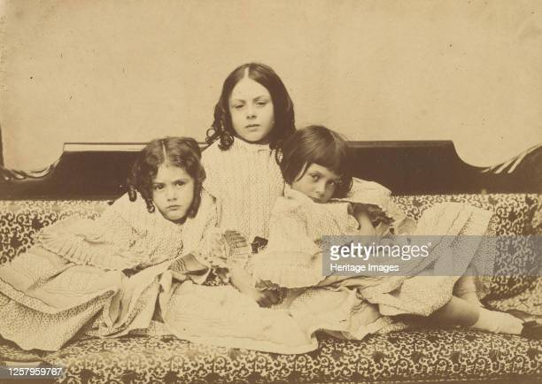 Edith Ina and Alice Liddell on a Sofa Summer 1858 Artist Lewis Carroll