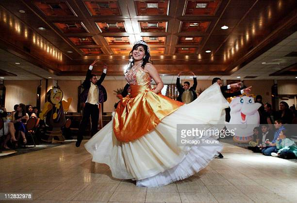 Edith Paniagua foreground performs with professional dancers at her quinceanera in suburban Darien Illinois February 20 2010
