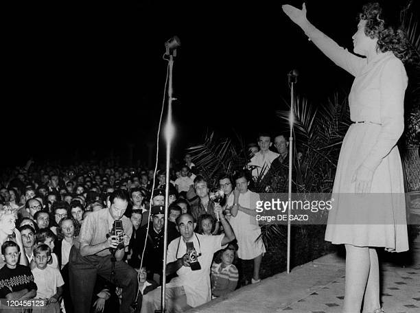 Edith Piaf on the Carlon hotel's terrace at the first Cannes film festival in Cannes France in 1946
