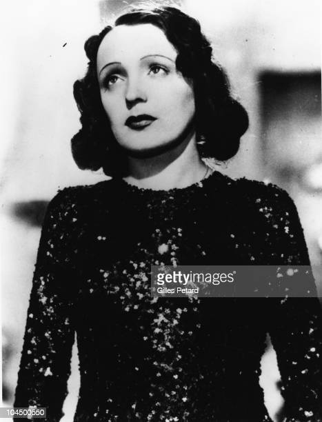 Edith Piaf poses for a studio portrait in 1940 in France
