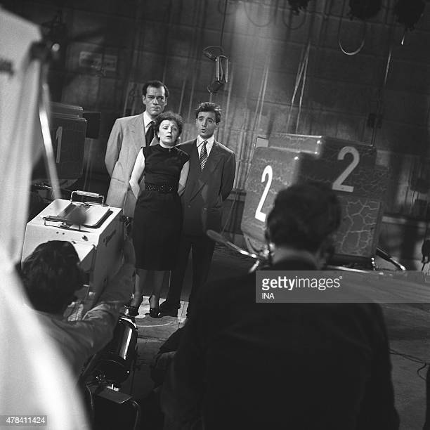 Edith Piaf surrounded with Eddie Constantine and with Charles Aznavour on the set XYZ First television of Edith Piaf and Charles Aznavour