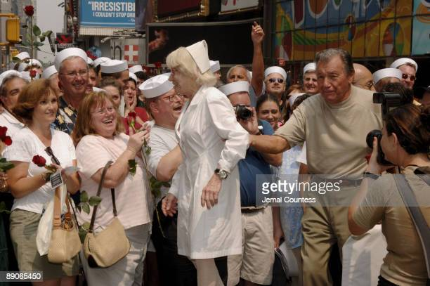 """Edith Shain and Carl Muscarello, the couple that appeared in Alfred Eisenstaedt's iconic photo """"The Kiss,"""" appear in New York City's Times Square to..."""
