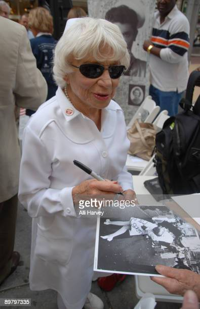 Edith Shain signs autographs after the reenactment of Alfred Eisenstaedt's famous photo of the Times Square victory kiss on August 14, 2009 in New...