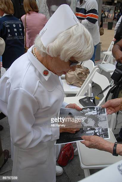 Edith Shain signs autographs after the reenactment of Alfred Eisenstaedt's famous photo of the Times Square victory kiss on August 14 2009 in New...
