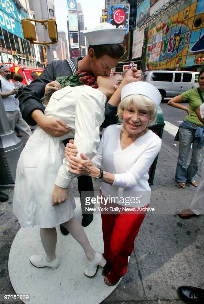 Edith Shain stands next to a statue depicting a US sailor and a nurse kissing that will be on display in Times Square until Aug 14 to commemorate the...