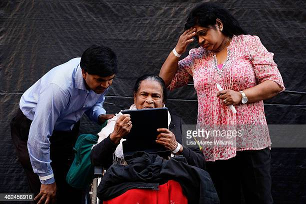 Edith Visvanathan the grandmother of Myuran Sukumaran speaks with Myuran on Skype via an iPad with family during the Music for Mercy concert and...