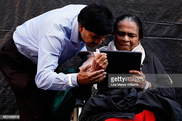 Edith Visvanathan the grandmother of Myuran Sukumaran speaks with Myuran on Skype via an iPad during the Music for Mercy concert and vigil at Martin...