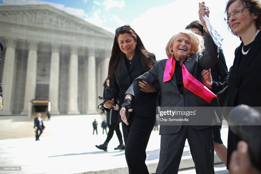 Edith Windsor (C), 83, acknowledges her supporters as she leaves the Supreme Court March 27, 2013 in Washington, DC. The Supreme Court heard oral arguments in the case 'Edith Schlain Windsor, in Her Capacity as Executor of the Estate of Thea Clara Spyer, Petitioner v. United States,' which challenges the constitutionality of the Defense of Marriage Act (DOMA), the second case about same-sex marriage this week.