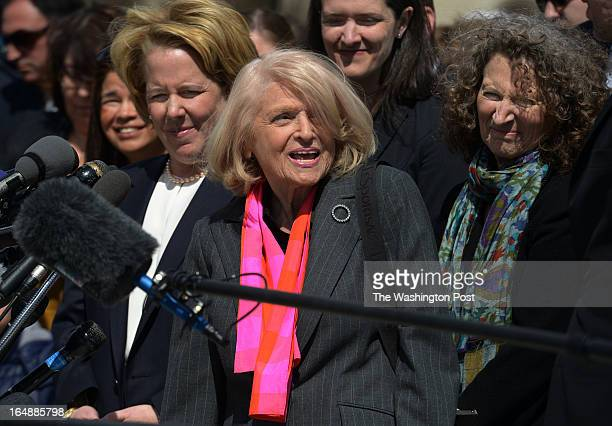 Edith Windsor, center, plaintiff in the Defense of Marriage Act currently before the Supreme Court, approaches gathered media as she exits the...