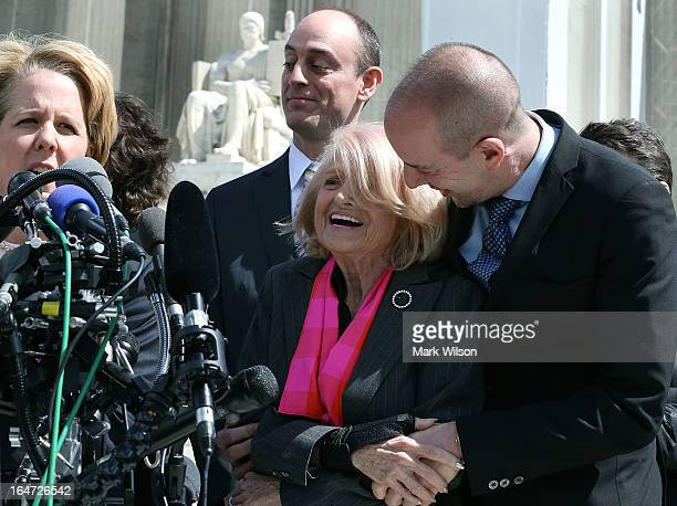 Edith Windsor gets a hug from Anthony D Romero of the American Civil Liberties Union while her attorney Roberta Kaplan speaks at the US Supreme Court...