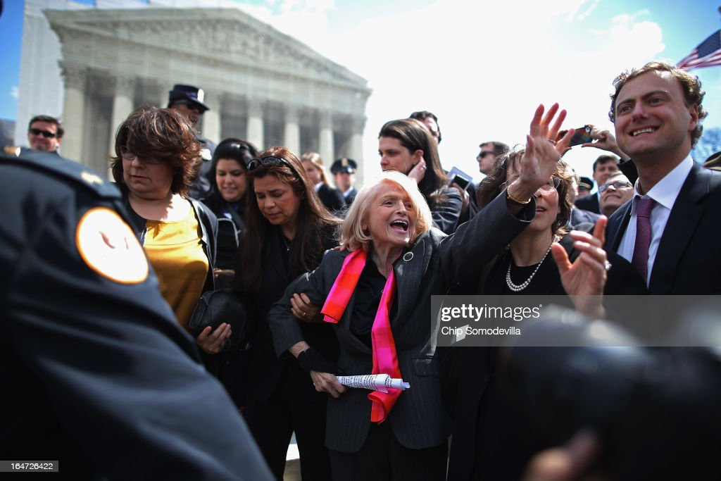 Edith Windsor (C), 83, is mobbed by journalists and supporters as she leaves the Supreme Court March 27, 2013 in Washington, DC. The Supreme Court heard oral arguments in the case 'Edith Schlain Windsor, in Her Capacity as Executor of the Estate of Thea Clara Spyer, Petitioner v. United States,' which challenges the constitutionality of the Defense of Marriage Act (DOMA), the second case about same-sex marriage this week.