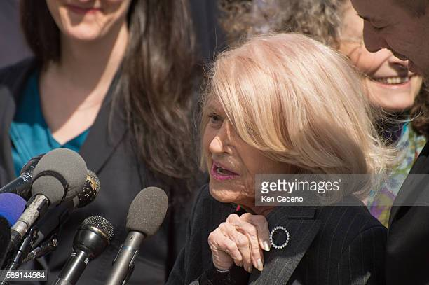 Edith Windsor shows the broach of diamonds she wears as an engagement ring while speaking to the press after she attended the hearing inside the US...