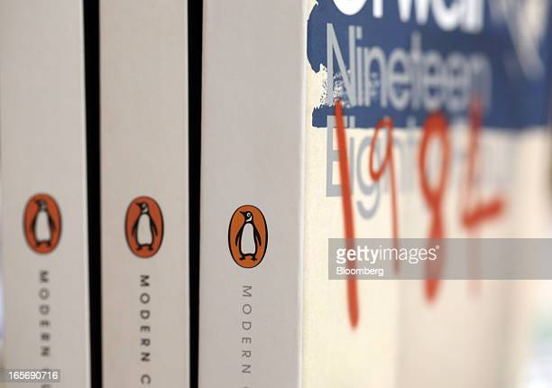 Editions of Penguin book's '1984' by George Orwell stand displayed at a bookstore in London UK on Friday April 5 2013 Bertelsmann SE's Random House...