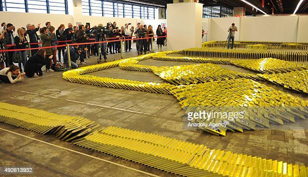 Editions of the Guinness Book of World Records fall during a world record attempt at book dominos during the 2015 Frankfurt Book Fair in Frankfurt am...