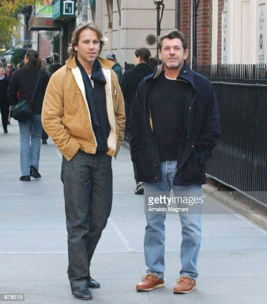 Editor and publisher of Rolling Stone magazine Jann Wenner and his boyfriend designer Matt Nye walk along Madison Avenue October 28 2001 in New York...